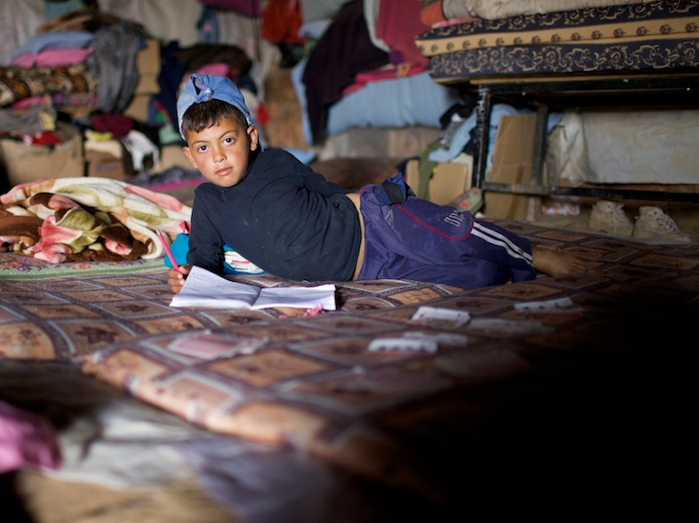 Photo of Palestinian boy with book. Photo by Rita Leistner.