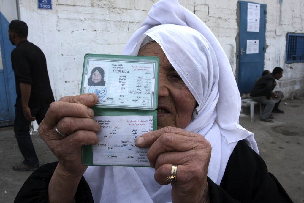 Photo of Palestinian woman showing ID. Photo by European Commission DG ECHO.