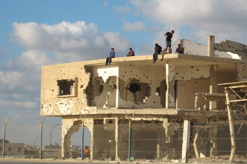 Palestinian children atop destroyed Gaza building