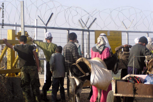 Photo of people at separation barrier