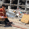 Photo of boy in Gaza ruins