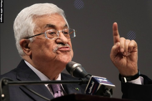 Palestinian President Mahmoud Abbas gives a speech during the opening ceremony of the 'Jerusalem in Memory' exhibition in the West Bank city of Ramallah