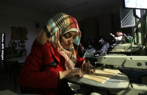 Deaf Palestinian women work in a carpentry workshop