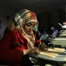 Deaf Palestinian women work in a carpentry workshop
