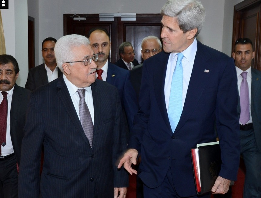 Palestinian President Mahmoud Abbas meets with U.S. Secretary of State John Kerry in the West Bank town of Ramallah, on Sunday, June 30, 2013. Kerry, engaged in breakneck shuttle diplomacy to coax Israel and the Palestinians back into peace talks, drove to the West Bank on Sunday to have a third meeting in as many days with Abbas. Photo by Thaer Ganaim