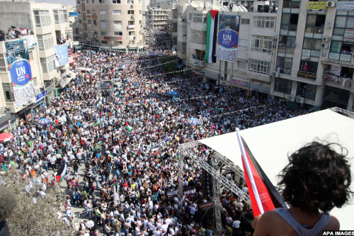 Palestinians participate in a rally in support of the Palestinian bid for statehood recognition in the United Nations, in the West Bank city of Ramallah, Wednesday, Sept. 21, 2011. Thousands of flag-waving Palestinians rallied Wednesday in towns across the West Bank to show support for their president's bid to win U.N. recognition of a Palestinian state. Photo by Issam Rimawi