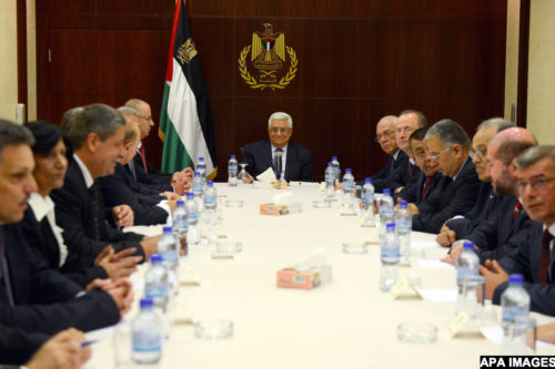 Palestinian President Mahmoud Abbas meets with the Ministers of reshuffled government following the oath ceremony in the West Bank city of Ramallah, 06 June 2013. Hamdallah and 24 ministers on 06 June took the oath before Palestinian President Mahmoud Abbas after a decision of reshuffling the government. Abbas chose the 54-year-old academic for the post after Salam Fayyad resigned in April and asked him to form a government. Photo by Thaer Ganaim