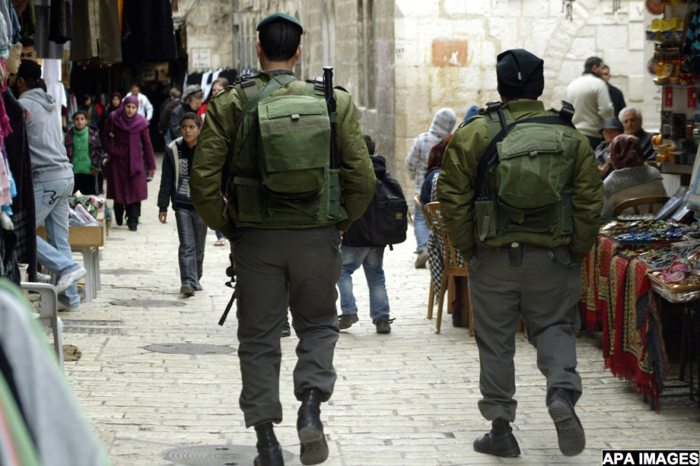 Israeli police officers walk in the market of the old city of Jerusalem on Feb. 3,2011.  Photo by Mahfouz Abu Turk